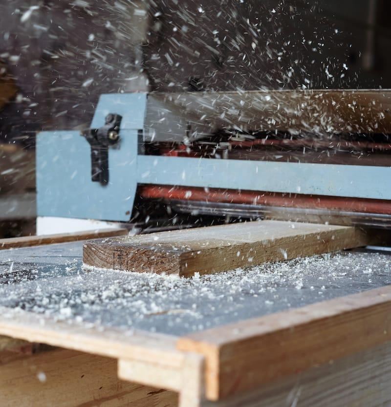 Power Sander on Piece of Wood